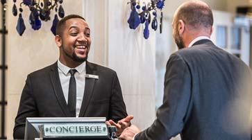 Concierge talking to a guest at the London Bridge hotel