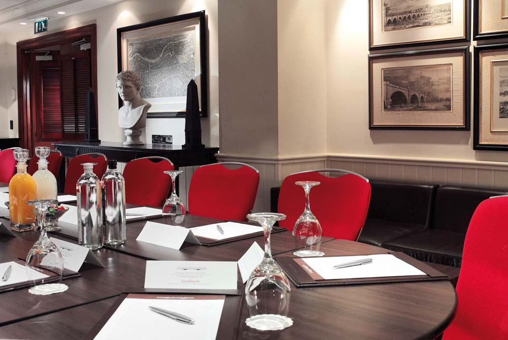 At the head of the Bridge Suite meeting room table